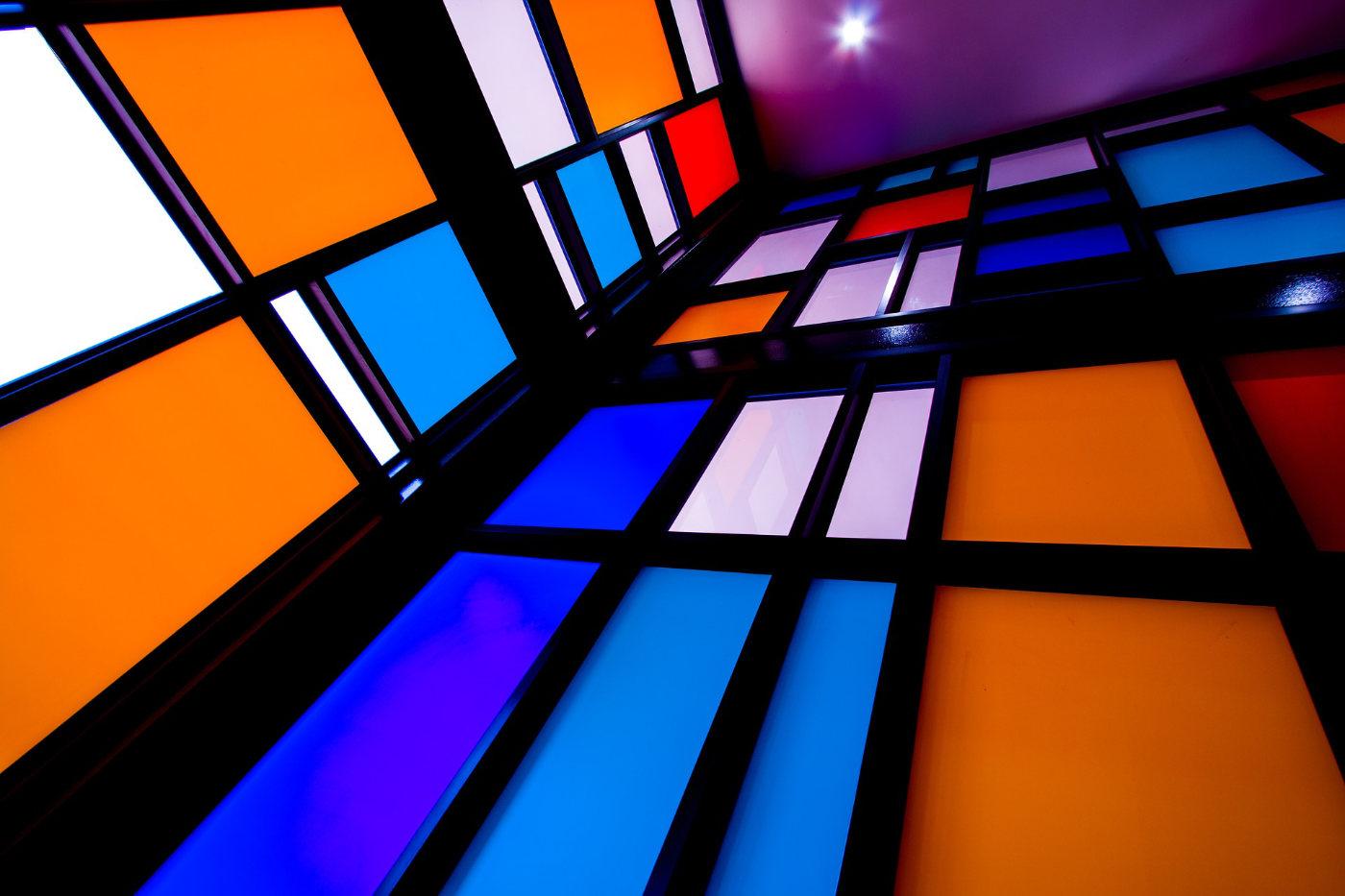 Coloured Mondrian-style glass in blues & orange in black frames